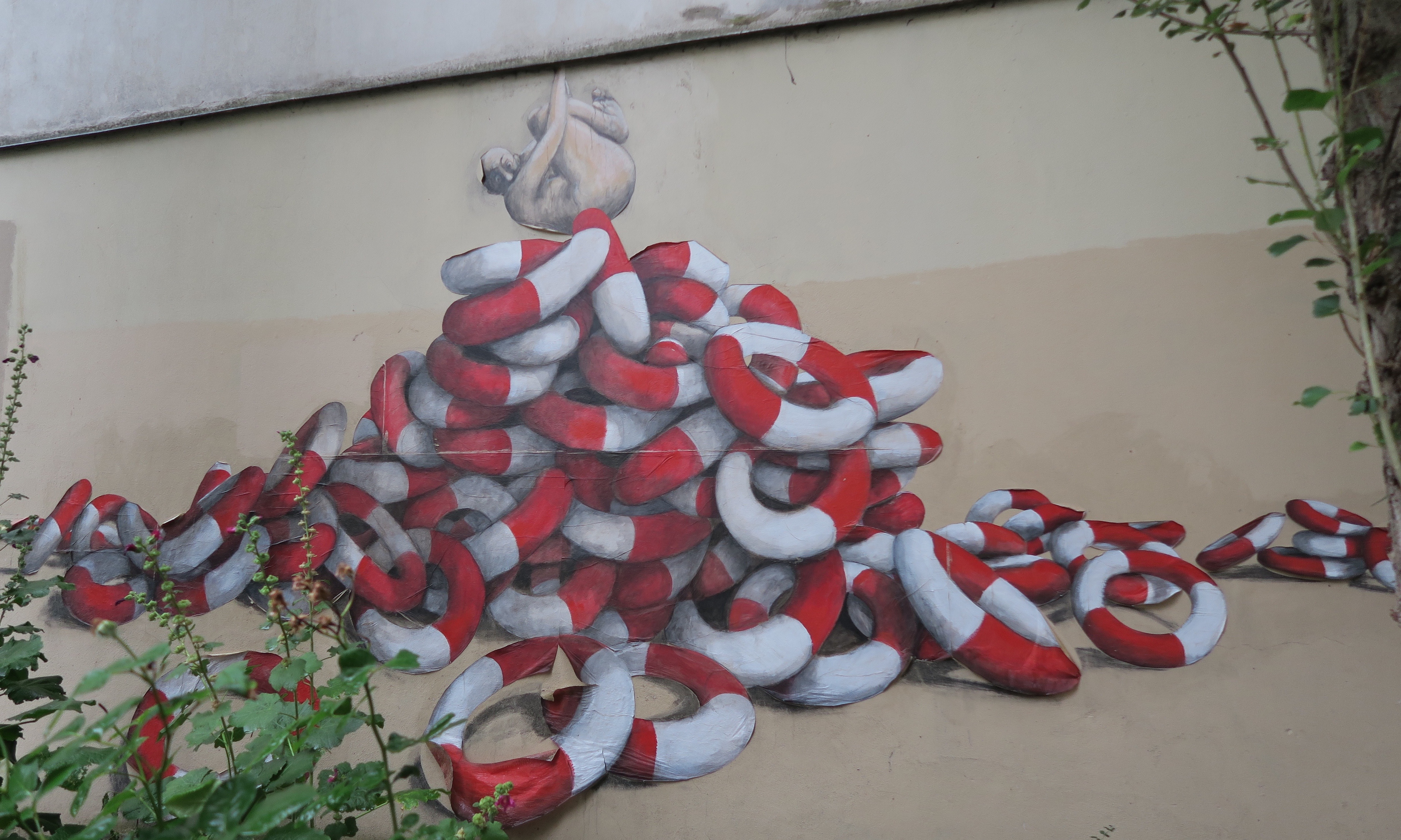 Street art by Philippe Girard with his signature life saver rings, Belleville