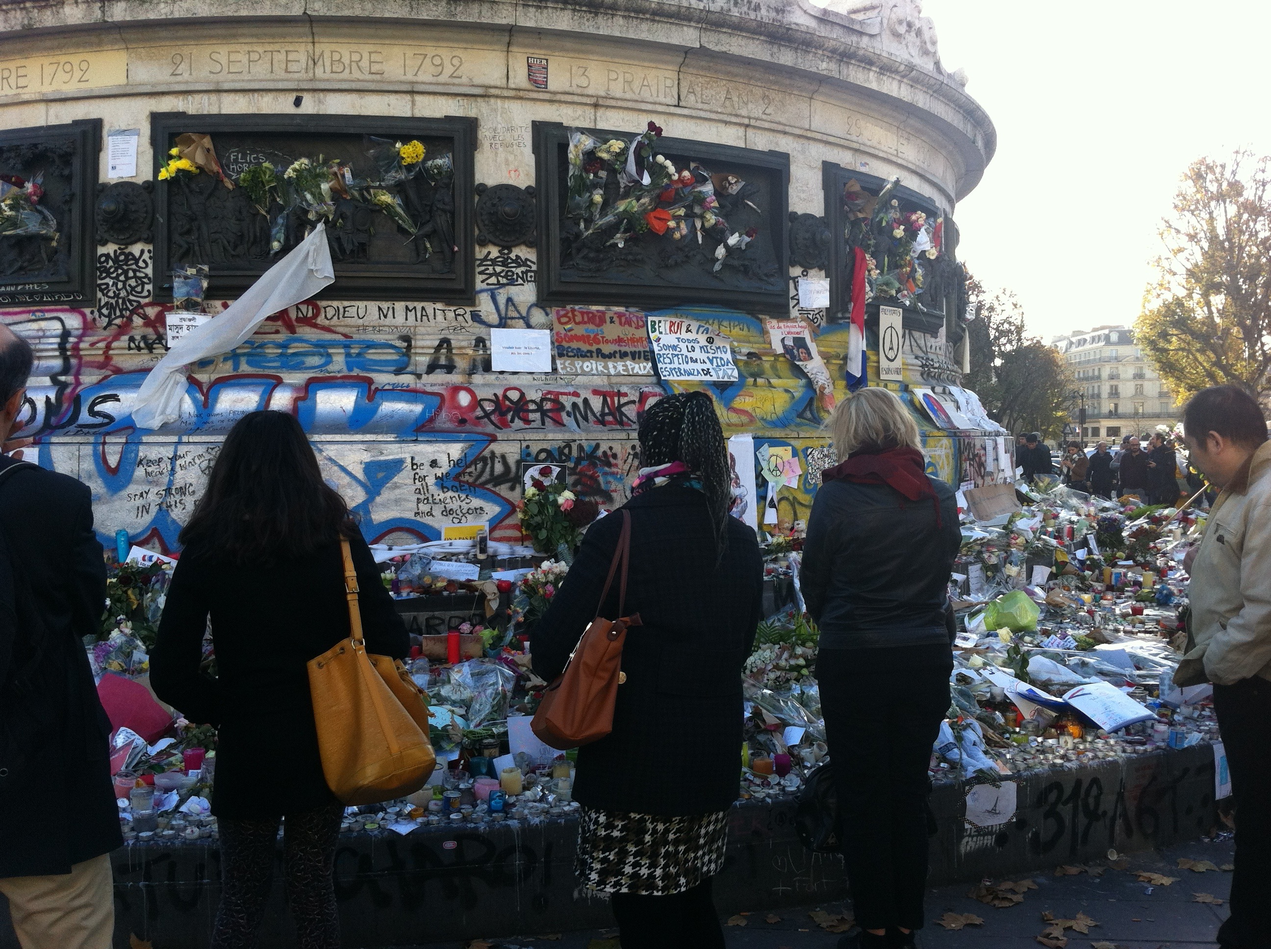 Memorial flowers and notes amass at Place de la Republique after the Nov. 13 attacks.